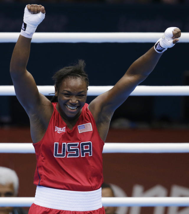 The United States' Claressa Shields, celebrates after winning her fight against Russia's Nadezda Torlopova, during the women's middleweight 75-kg boxing gold medal match at the 2012 Summer Olympics, Thursday, Aug. 9, 2012, in London. (AP Photo/Patrick Semansky)