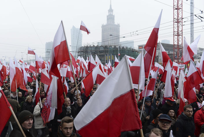 Thousands walk in the annual March of Independence organized by far right activists to celebrate 100 years of Poland's independence the nation regaining its sovereignty at the end of World War I after being wiped off the map for more than a century. (AP Photo/Alik Keplicz)