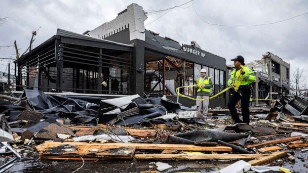 PHOTO: Police at the scene of a damage caused by a tornado in Nashville, Tenn., March 3, 2020. (Alan Poizner/The Tennessean via USA TODAY )