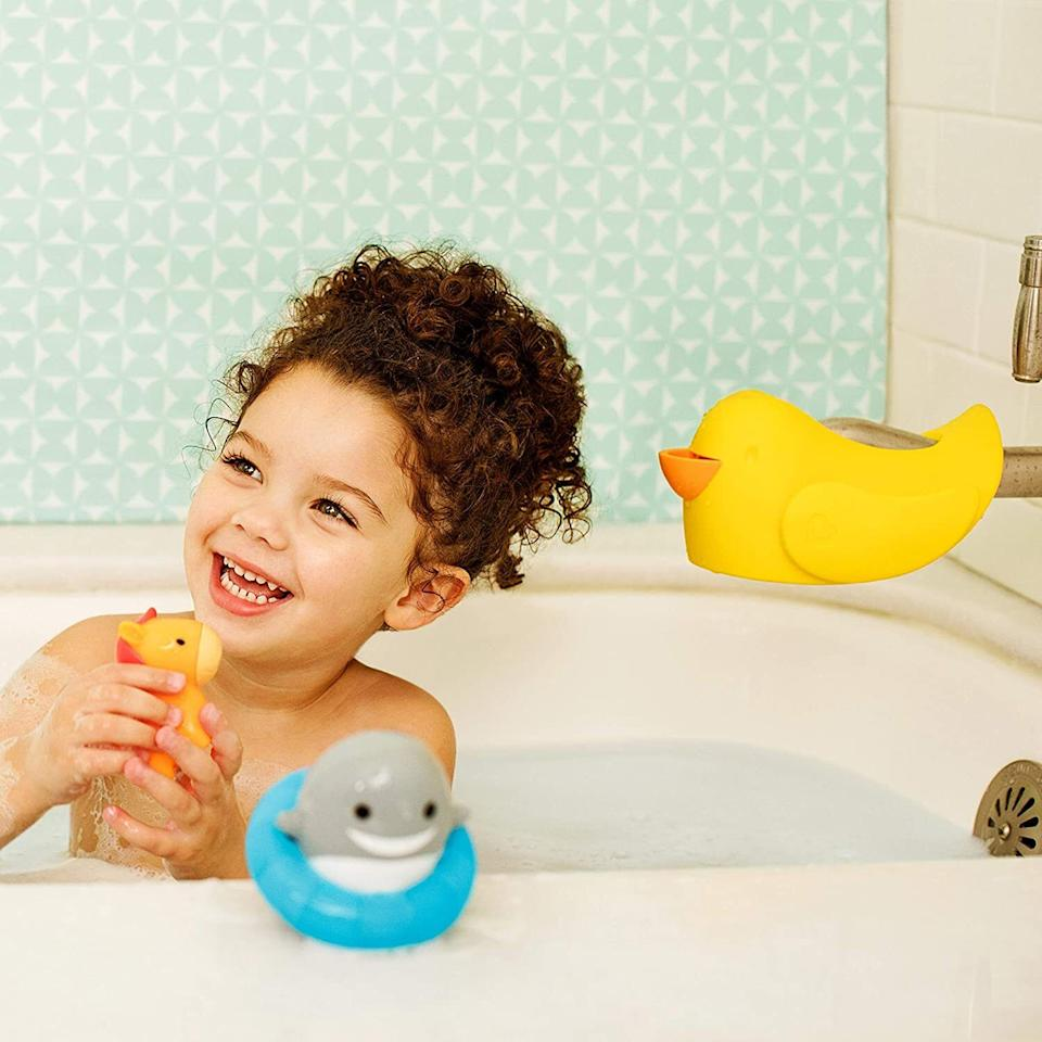 """Put this over the faucet to keep your kiddo from ~quacking~ their head open if they're rather squirmy during bath time.<br /><br /><strong>Promising review:</strong>""""<strong>This was super easy to install,</strong>and I love how it looks in our bathtub along with our daughter's other duckies! We've only had this spout cover a week or so, but so far we're very satisfied."""" —<a href=""""https://www.amazon.com/gp/customer-reviews/R3IUX4KM5IMS7X?&linkCode=ll2&tag=huffpost-bfsyndication-20&linkId=799f88edf72c20b9429d188e96f3e941&language=en_US&ref_=as_li_ss_tl"""" target=""""_blank"""" rel=""""nofollow noopener noreferrer"""" data-skimlinks-tracking=""""5750537"""" data-vars-affiliate=""""Amazon"""" data-vars-href=""""https://www.amazon.com/gp/customer-reviews/R3IUX4KM5IMS7X?tag=bfmal-20&ascsubtag=5750537%2C7%2C33%2Cmobile_web%2C0%2C0%2C0"""" data-vars-keywords=""""cleaning,fast fashion"""" data-vars-link-id=""""0"""" data-vars-price="""""""" data-vars-retailers=""""Amazon"""">Audrey N.</a><br /><br /><strong>Get it from Amazon for<a href=""""https://www.amazon.com/gp/customer-reviews/R3IUX4KM5IMS7X?&linkCode=ll2&tag=huffpost-bfsyndication-20&linkId=799f88edf72c20b9429d188e96f3e941&language=en_US&ref_=as_li_ss_tl"""" target=""""_blank"""" rel=""""nofollow noopener noreferrer"""" data-skimlinks-tracking=""""5750537"""" data-vars-affiliate=""""Amazon"""" data-vars-asin=""""B01MQZAUHZ"""" data-vars-href=""""https://www.amazon.com/dp/B01MQZAUHZ?tag=bfmal-20&ascsubtag=5750537%2C7%2C33%2Cmobile_web%2C0%2C0%2C16106969"""" data-vars-keywords=""""cleaning,fast fashion"""" data-vars-link-id=""""16106969"""" data-vars-price="""""""" data-vars-product-id=""""16340711"""" data-vars-product-img=""""https://m.media-amazon.com/images/I/31LIrEG7ttL._SL500_.jpg"""" data-vars-product-title=""""Munchkin Bubble Beak Bath Spout Cover Safety Guard, Yellow"""" data-vars-retailers=""""Amazon"""">$9.78</a>.</strong>"""
