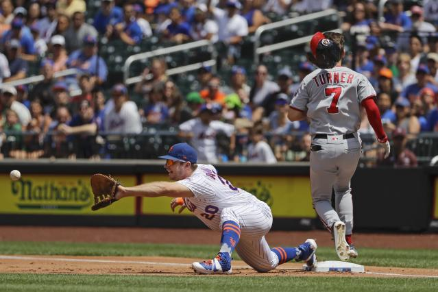 Washington Nationals' Trea Turner (7) beats the throw to first base as New York Mets' Pete Alonso (20) stretches to field the ball during the first inning of a baseball game Sunday, Aug. 11, 2019, in New York. (AP Photo/Frank Franklin II)