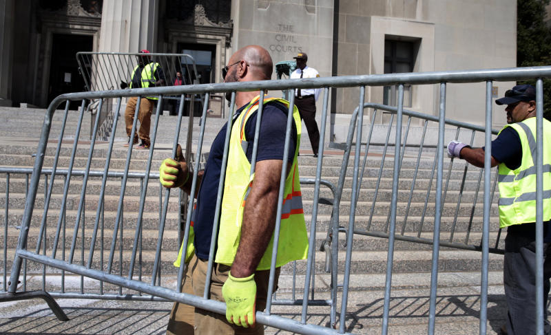City workers erect barricades around the Civil Courts and Carnahan courthouses on Aug. 29, 2017, in St. Louis.