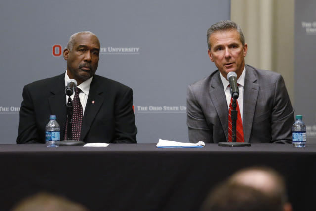 Ohio State football coach Urban Meyer, right, answers questions as athletic director Gene Smith listens during a news conference in Columbus, Ohio, Wednesday, Aug. 22, 2018. (AP Photo/Paul Vernon)