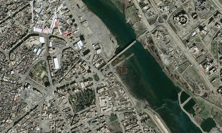 Cropped image of a photo taken by EADS' Astrium Press from the Pleiades Satellite on February 19, 2017 shows a view of the second bridge of Mosul's five damaged or destroyed bridges across the Tigris River