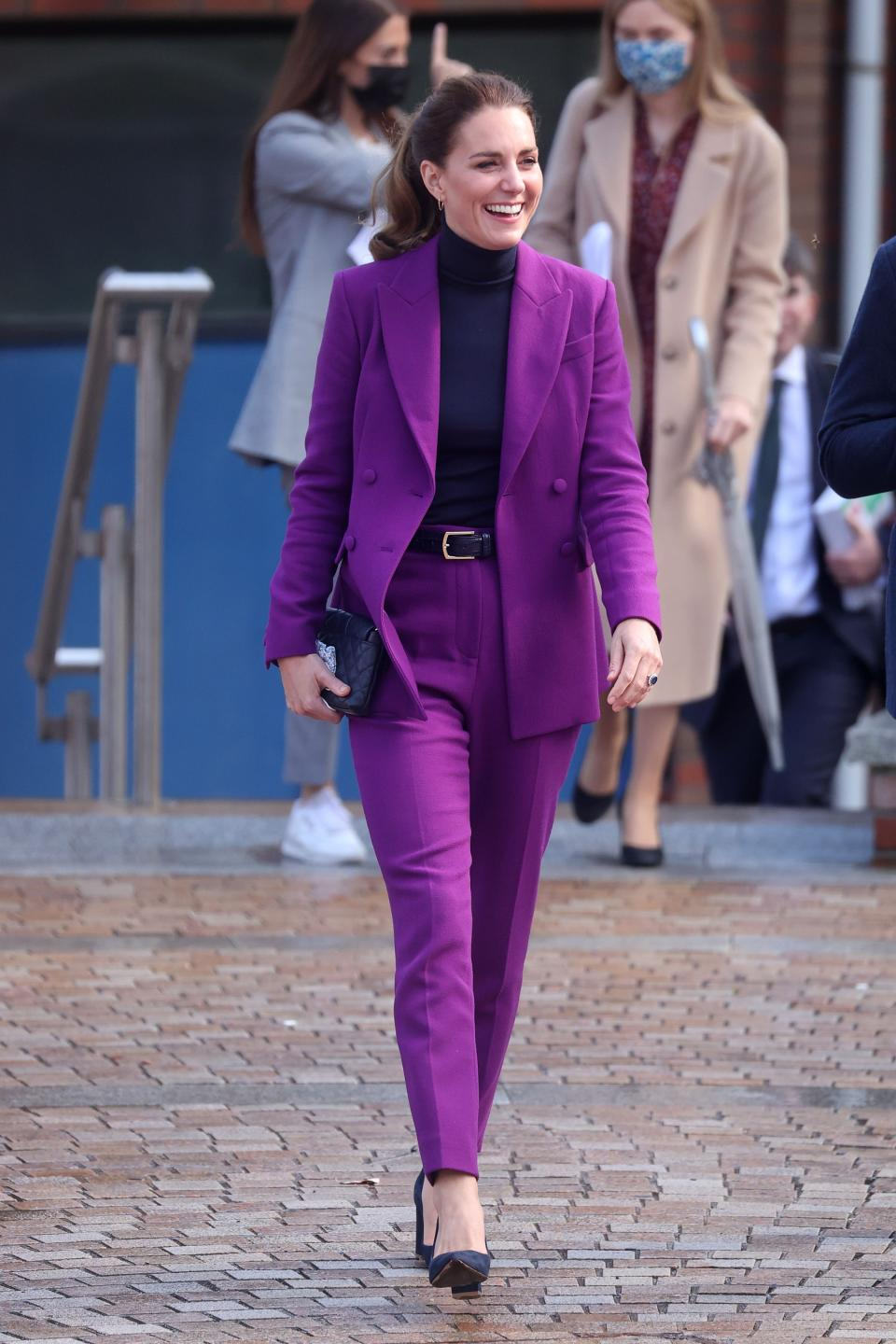 Catherine, Duchess of Cambridge wears a purple suit at the Ulster University Magee Campus on September 29, 2021 in Londonderry, Northern Ireland. (Photo by Pool/Samir Hussein/WireImage)