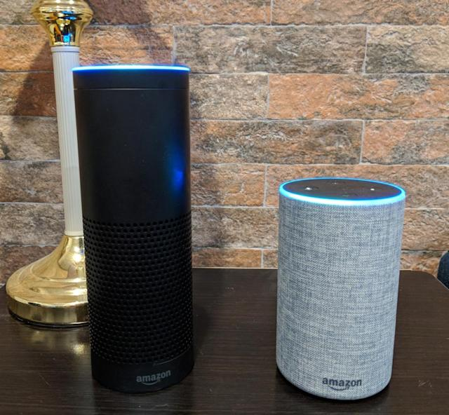 The new Echo next to the older, taller Echo.