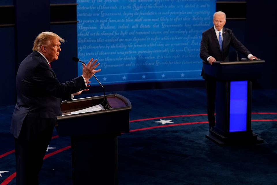President Donald Trump answers a question as Democratic presidential candidate former Vice President Joe Biden listens during the second and final presidential debate at Belmont University on Oct. 22. (Photo: Pool via Getty Images)