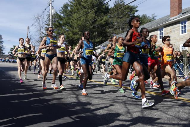 Runners compete near the start in the women's division of the 118th Boston Marathon Monday, April 21, 2014 in Hopkinton, Mass. (AP Photo/Michael Dwyer)s