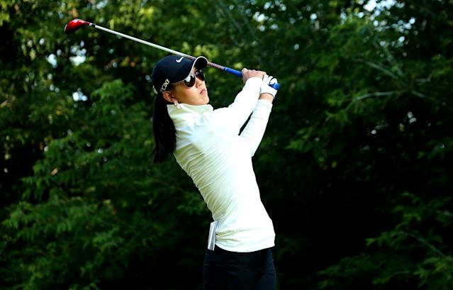 EDMONTON, AB - AUGUST 23: Michelle Wie hits her tee shot on the sixth hole during the second round of the CN Canadian Women's Open at Royal Mayfair Golf Club on August 23, 2013 in Edmonton, Alberta, Canada. (Photo by Stephen Dunn/Getty Images)