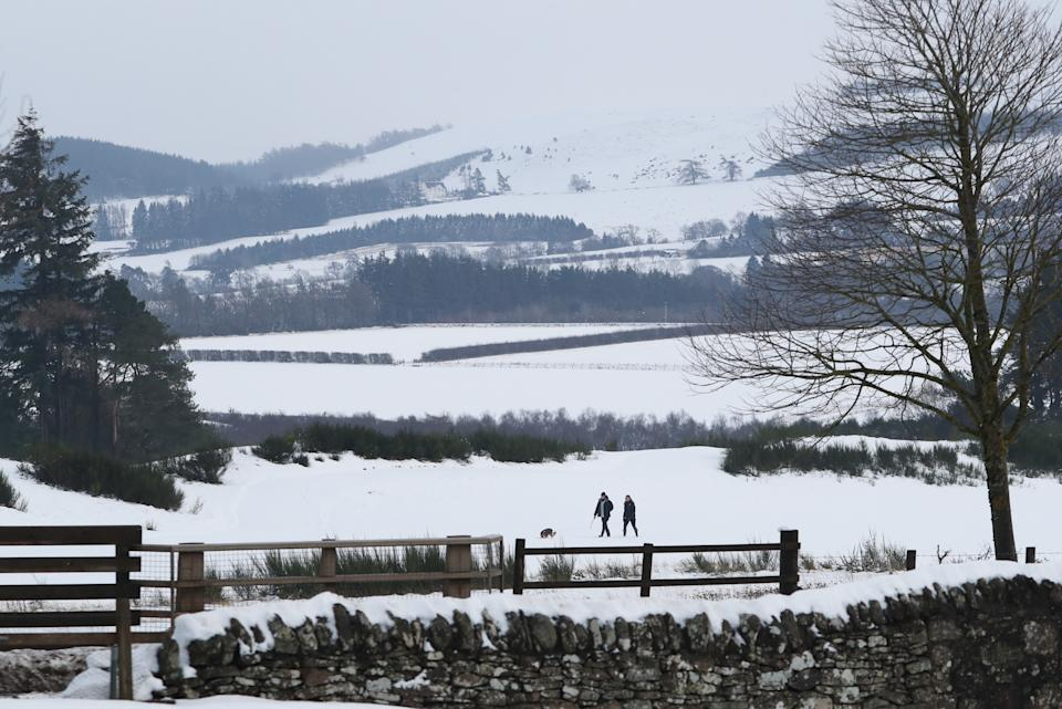 People walk in the snow at Gleneagles in Auchterarder, Perthshire. Heavy snow and freezing rain is set to batter the UK this week, with warnings issued over potential power cuts and travel delays. (Photo by Andrew Milligan/PA Images via Getty Images)