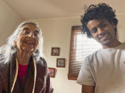 In this photo provided by courtesy of Arman Ramnath, Arman poses with his grandmother, Vijaya Ramnath, Feb. 14, 2021, in Columbus, Ohio. Ramanth, 27, has been nervous about getting near his older grandmother, Vijaya, during the coronavirus pandemic, especially whenever he has just returned from Washington, where he is a Georgetown University Law School student. He is studying remotely but sometimes must visit school such as to pick up books. (Arman Ramnath via AP)