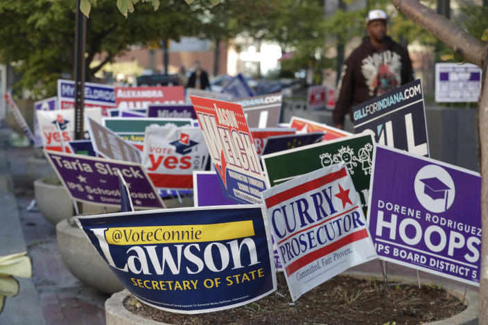 <p>Signs for candidates in the upcoming Nov. 6 election fill flower beds outside an early voting center at the City County Building in Indianapolis, Tuesday, Oct. 23, 2018. (Photo: Michael Conroy/AP) </p>