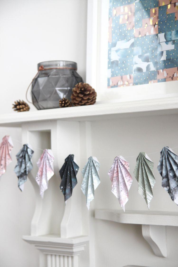 """<p>Learn some new origami techniques, and make a fresh garland for your fireplace using this tutorial. You'll love its unexpected colors for fall.</p><p><strong>Get the tutorial at <a href=""""https://www.gatheringbeauty.com/blog/diy-autumn-origami-accordion-folded-paper-leaf-garland"""" rel=""""nofollow noopener"""" target=""""_blank"""" data-ylk=""""slk:Gathering Beauty"""" class=""""link rapid-noclick-resp"""">Gathering Beauty</a>.</strong></p><p><a class=""""link rapid-noclick-resp"""" href=""""https://go.redirectingat.com?id=74968X1596630&url=https%3A%2F%2Fwww.walmart.com%2Fsearch%2F%3Fquery%3Dcraft%2Bglue&sref=https%3A%2F%2Fwww.thepioneerwoman.com%2Fhome-lifestyle%2Fcrafts-diy%2Fg36891743%2Ffall-mantel-decorations%2F"""" rel=""""nofollow noopener"""" target=""""_blank"""" data-ylk=""""slk:SHOP GLUE"""">SHOP GLUE</a></p>"""