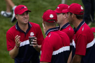 Team USA's Justin Thomas talks to teammates after winning the Ryder Cup at the Whistling Straits Golf Course Sunday, Sept. 26, 2021, in Sheboygan, Wis. (AP Photo/Jeff Roberson)