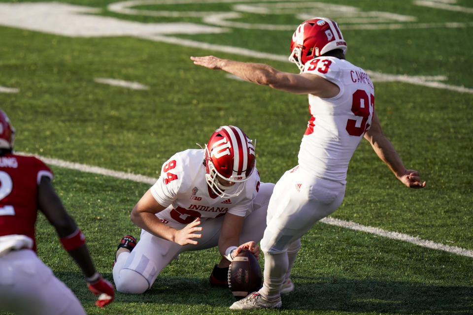 Indiana's Haydon Whitehead (94) holds the ball as Charles Campbell (93) kicks a field goal during the second quarter of the team's NCAA college football game against Rutgers, Saturday, Oct. 31, 2020, in Piscataway, N.J. (AP Photo/Corey Sipkin)