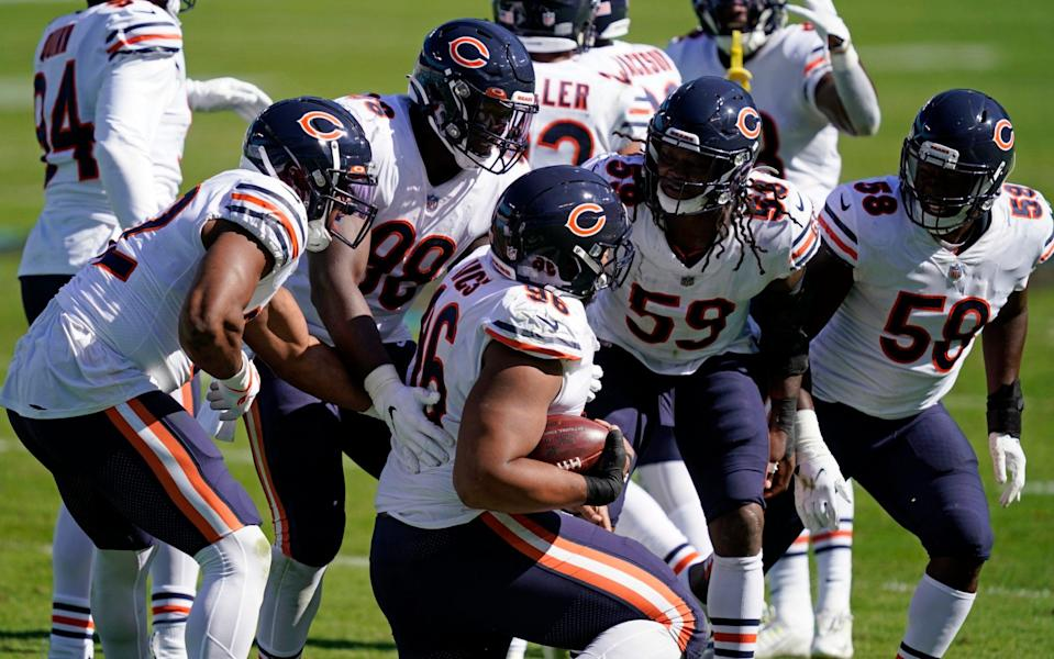 Chicago Bears defensive end Akiem Hicks (96) is congratulated by teammates following a turnover during the second half of an NFL football game against the Carolina Panthers in Charlotte, N.C., Sunday, Oct. 18, 2020. - AP