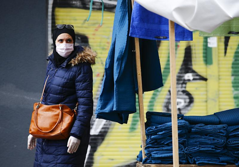 BERLIN, GERMANY - APRIL 14: People, wearing medical masks as a precaution against the new type of coronavirus (COVID-19) pandemic, shop at marketplace in Berlin's Kreuzberg known as the district where the Turks live the most in Germany on April 14, 2020. Coronavirus measures were also implemented at the market place established in Kreuzberg. (Photo by Abdulhamid Hosbas/Anadolu Agency via Getty Images)