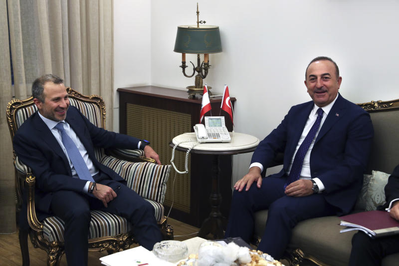 Lebanese Foreign Minister Gibran Bassil, left, meets with his Turkish counterpart Mevlut Cavusoglu, at the Lebanese foreign ministry, in Beirut, Lebanon, Friday, Aug. 23, 2019. (AP Photo/Bilal Hussein)