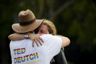 """Rep. Debbie Wasserman Schultz, D-Fla., is comforted after a truck drove into a crowd of people during The Stonewall Pride Parade and Street Festival in Wilton Manors, Fla., Saturday, June 19, 2021. A driver has slammed into spectators at the start of a Pride parade in South Florida, injuring at least two people. Wilton Manors police tweeted Saturday night that the parade was canceled due to a """"tragic event."""" (Chris Day/South Florida Sun-Sentinel via AP)"""