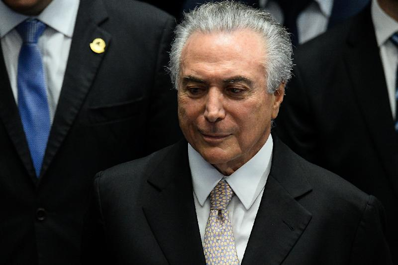 New Brazilian President Michel Temer says he wants to create jobs and stability (AFP Photo/Andressa Anholete)