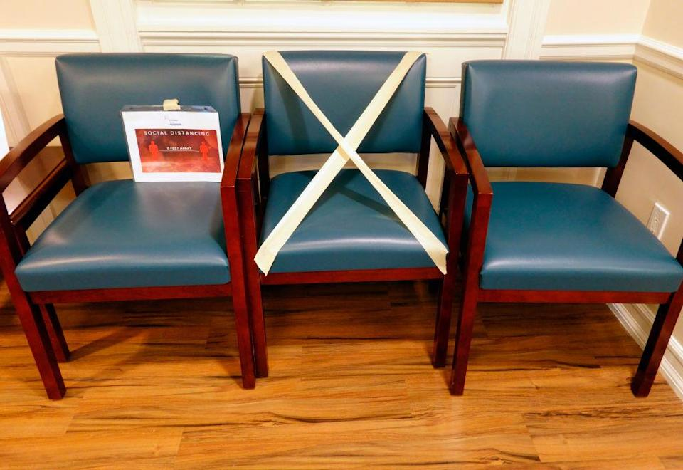 Social distancing chairs taped off in patient waiting area, Lenox Hill Hospital, New York City