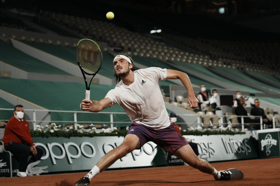Stefanos Tsitsipas of Greece returns the ball to Russia's Daniil Medvedev during their quarterfinal match of the French Open tennis tournament at the Roland Garros stadium Tuesday, June 8, 2021 in Paris. (AP Photo/Thibault Camus)