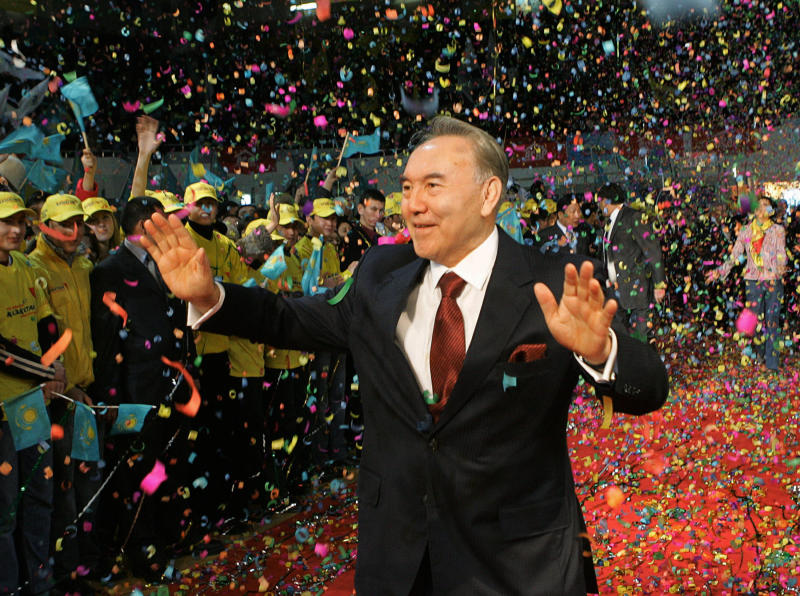 FILE - In this Dec. 5, 2005, file photo, Kazakhstan's President Nursultan Nazarbayev waves to supporters after his victory in Sunday's presidential election was officially announced in the capital of Astana. Nazarbayev, the only leader that independent Kazakhstan has ever known, abruptly announced his resignation Tuesday, March 19, 2019, after three decades in power. (Presidential Press Service/Pool Photo via AP, File)