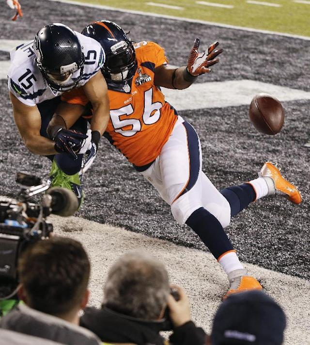 Denver Broncos outside linebacker Nate Irving (56) breaks up a pass in the end zone intended for Seattle Seahawks wide receiver Jermaine Kearse (15) during the first half of the NFL Super Bowl XLVIII football game Sunday, Feb. 2, 2014, in East Rutherford, N.J. (AP Photo/Kathy Willens)