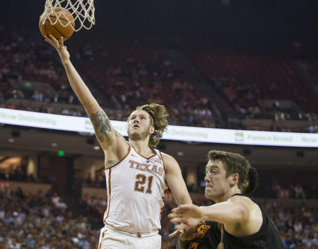 Texas forward Dylan Osetkowski (21) shoots a layup during an NCAA college basketball game against Oklahoma State in Austin, Texas, on Saturday, Feb. 24, 2018. (Nick Wagner /Austin American-Statesman via AP)