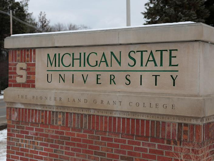 A sign for Michigan State University is seen near the campus in East Lansing.JPG