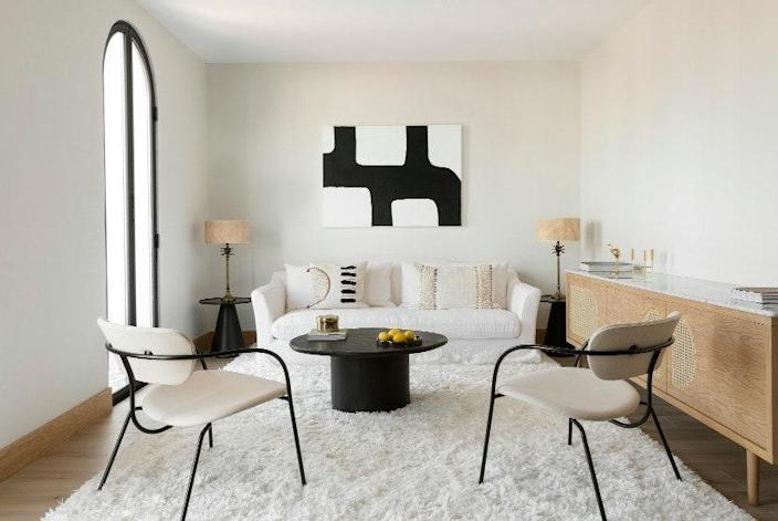 AFTER: In the living room, the sofa and Pavilion AV5 lounge chairs (designed by Anderssen & Voll) by &Tradition sit on a Benuta rug. The Arco TV cabinet is by Noé Prades Studio.