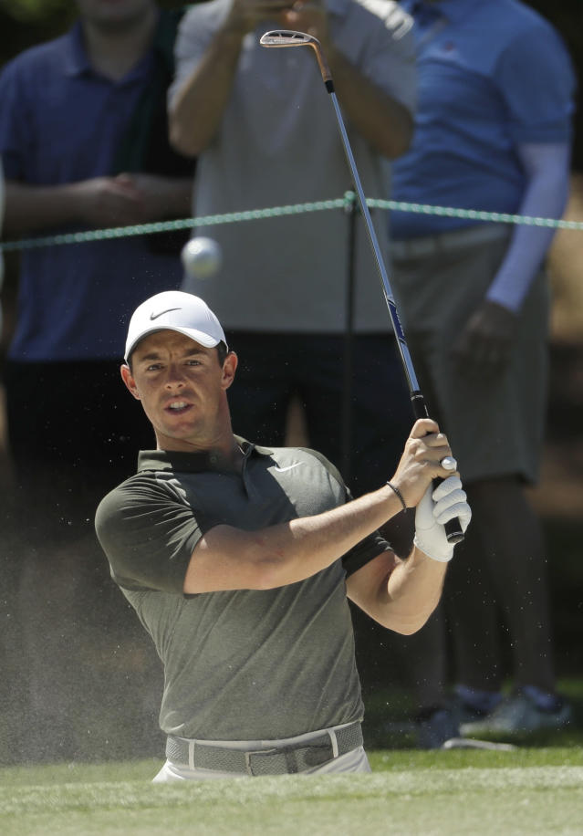 Rory McIlroy, of Northern Ireland, watches his shot from a sand trap on the sixth hole during the pro-am of the Wells Fargo Championship golf tournament at Quail Hollow Club in Charlotte, N.C., Wednesday, May 2, 2018. McIlroy looks to bounce back after a disappointing performance at the Masters on one of his favorite courses, Quail Hollow Club. (AP Photo/Chuck Burton)