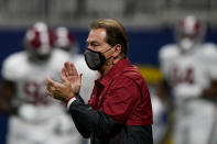 FILE - In this Saturday, Dec. 19, 2020, file photo, Alabama head coach Nick Saban watches his team warm up before the Southeastern Conference championship NCAA college football game against Florida in Atlanta. (AP Photo/Brynn Anderson, File)