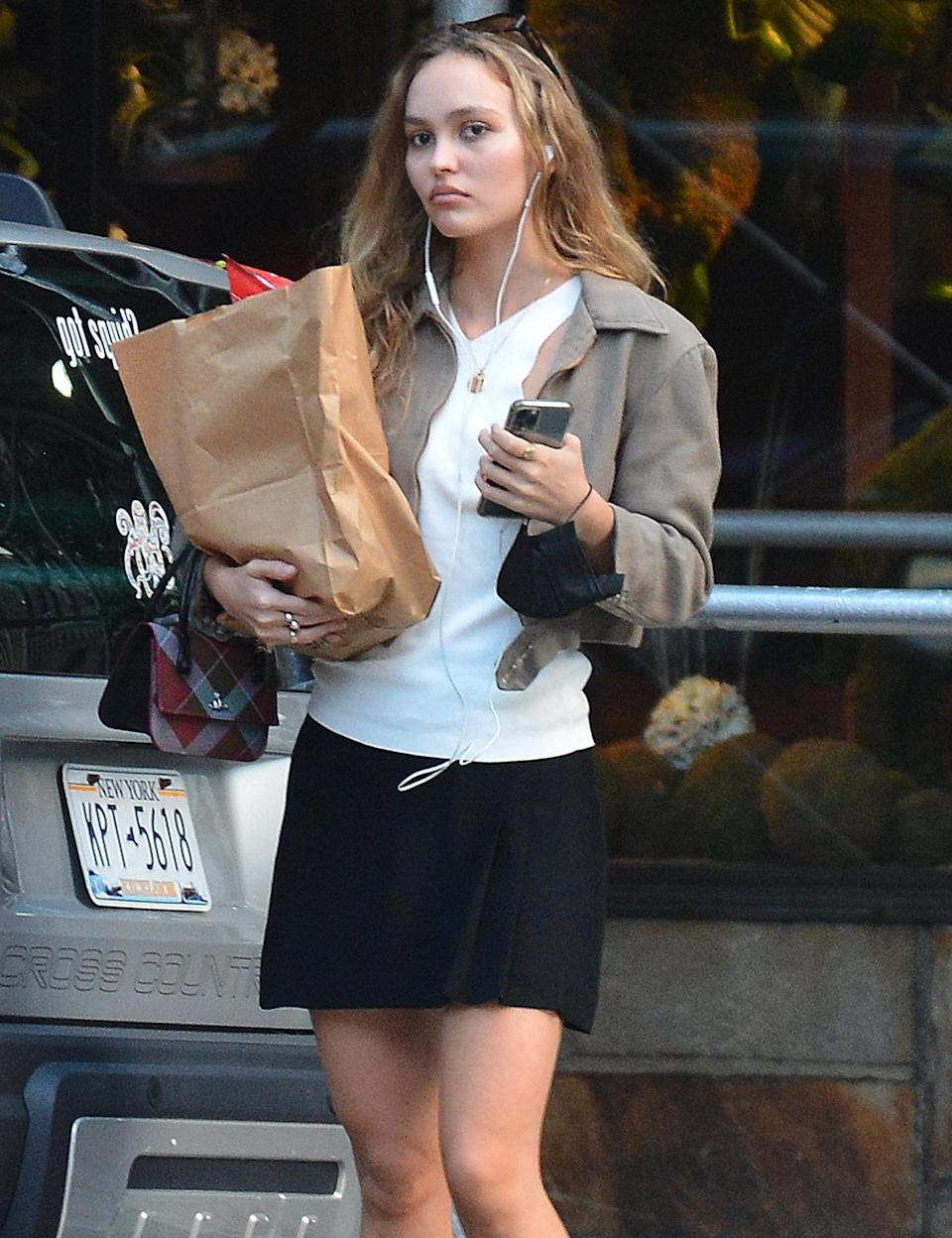 <p>Lily-Rose Depp has her hands full as she runs errands in N.Y.C. on Sept. 2.</p>
