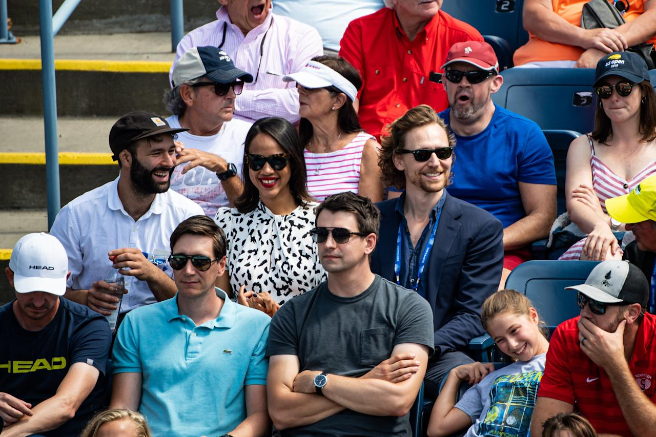 Tom Hiddleston and Zawe Ashton watch Johanna Konta of Great Britain against Daria Kasatkina of Russia on court 17 in the first round of the US Open at the USTA Billie Jean King National Tennis Center on August 26, 2019 in New York City. Photo courtesy of Getty Images.