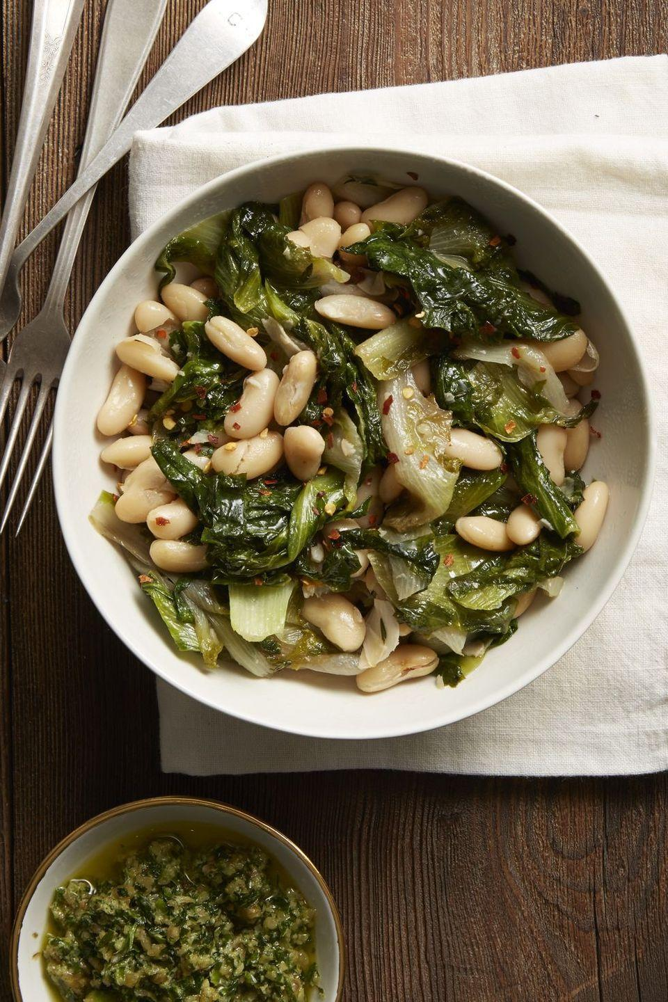 """<p>Nope, there is no such thing as """"too much green"""" on the dinner table. </p><p><em><a href=""""https://www.goodhousekeeping.com/food-recipes/easy/a35797/garlicky-beans-and-greens/"""" rel=""""nofollow noopener"""" target=""""_blank"""" data-ylk=""""slk:Get the recipe for Garlicky Beans and Greens »"""" class=""""link rapid-noclick-resp"""">Get the recipe for Garlicky Beans and Greens »</a></em></p><p><strong>RELATED: </strong><a href=""""https://www.goodhousekeeping.com/holidays/christmas-ideas/g1875/healthy-diet-christmas-recipes/"""" rel=""""nofollow noopener"""" target=""""_blank"""" data-ylk=""""slk:35 Healthy Christmas Recipes That Still Taste Totally Indulgent"""" class=""""link rapid-noclick-resp"""">35 Healthy Christmas Recipes That Still Taste Totally Indulgent</a></p>"""