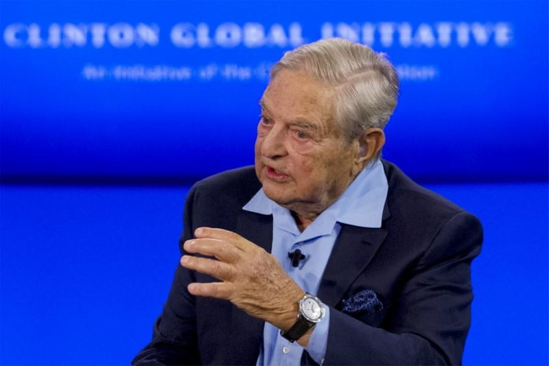 Billionaire hedge fund manager George Soros speaks during a discussion at the Clinton Global Initiative's annual meeting in New York