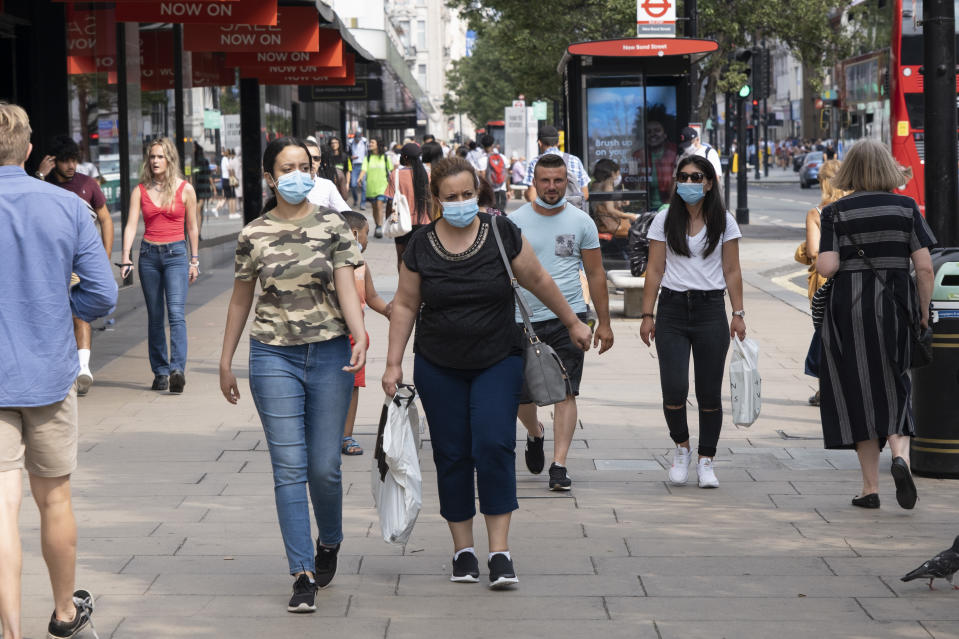 As Britain enters a period of deep recession, with some shops closing either temporarily or permanently as the economic downturn caused by the Covid-19 pandemic cuts hard, shoppers wearing face masks continue to come to the West End to Oxford Street on 13th August 2020 in London, United Kingdom. The Office for National Statistics / ONS has announced that gross domestic product / GDP, the widest gauge of economic health, fell by 20.4% in the second quarter of the year, compared with the previous quarter. This is the biggest decline since records began. The result is that Britain has officially entered recession, as the UK economy shrank more than any other major economy during the coronavirus outbreak. (photo by Mike Kemp/In PIctures via Getty Images)