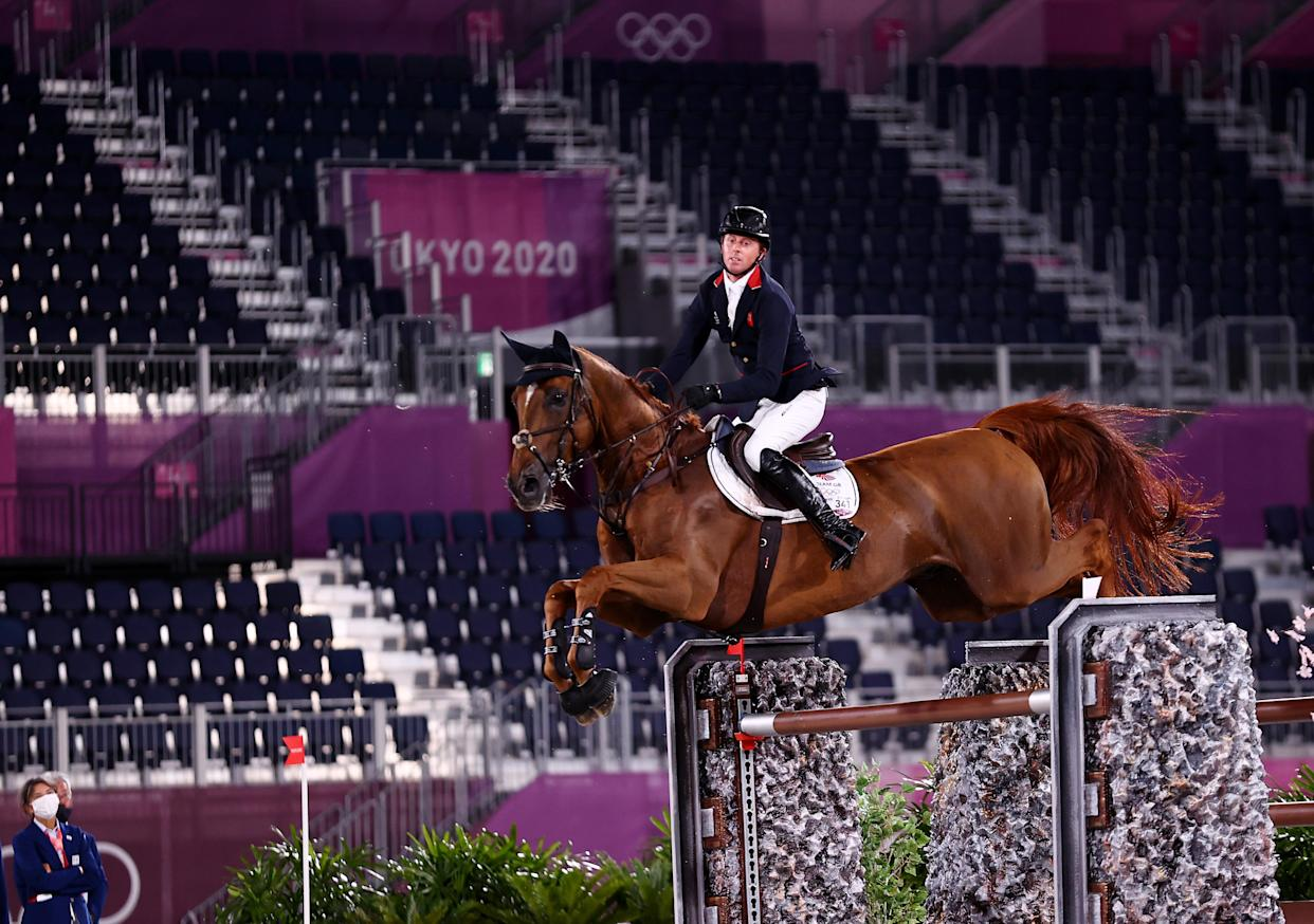 Tokyo 2020 Olympics - Equestrian - Jumping - Individual - Final - Equestrian Park - Tokyo, Japan - August 4, 2021. Ben Maher of Britain on his horse Explosion W competes during the jump-off. REUTERS/Amr Abdallah Dalsh