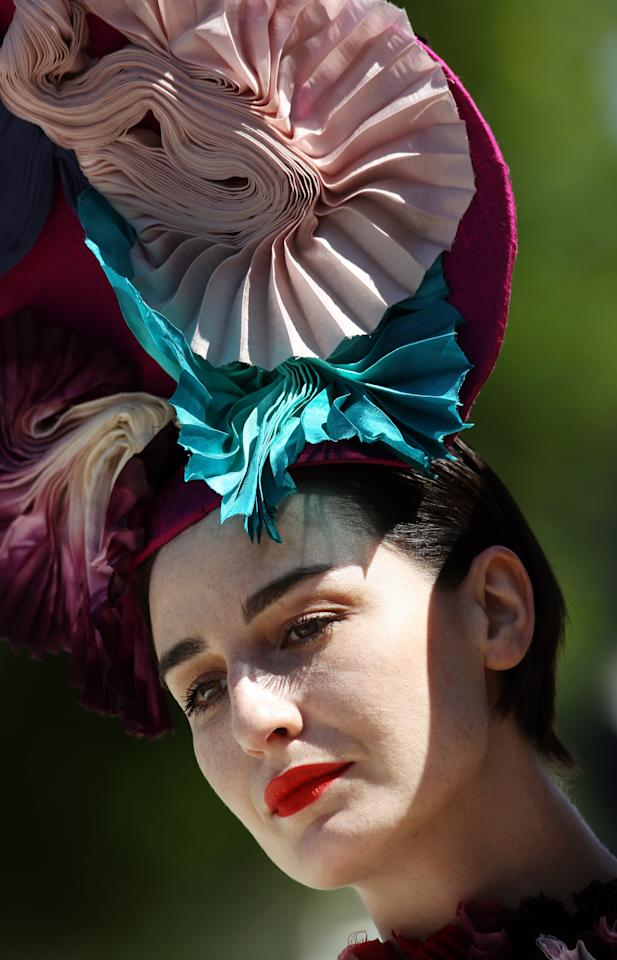 British model Erin O'Connor poses for photographers during 'Ladies Day' on the first day of the Epsom Derby Festival in Surrey, southern England, on June 3, 2011. The Epsom Derby race will be run Saturday June 4, 2011. AFP PHOTO/ ADRIAN DENNIS (Photo credit should read ADRIAN DENNIS/AFP/Getty Images)