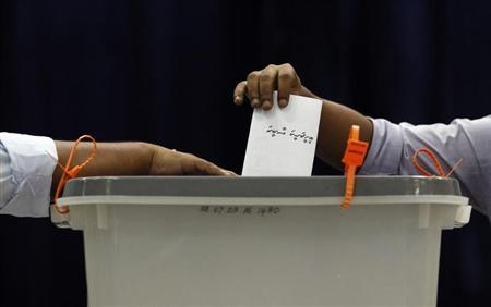 A man casts his vote at a polling centre during the presidential elections in Male