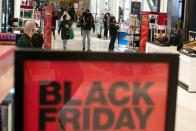 People visit Macy's Herald Square during early opening for the Black Friday sales in Manhattan, New York