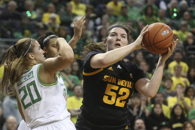 Arizona State's Jamie Ruden, right, looks to shoot against Oregon's Sabrina Ionescu, left, during the second quarter of an NCAA college basketball game in Eugene, Ore., Sunday, Feb. 9, 2020. (AP Photo/Chris Pietsch)