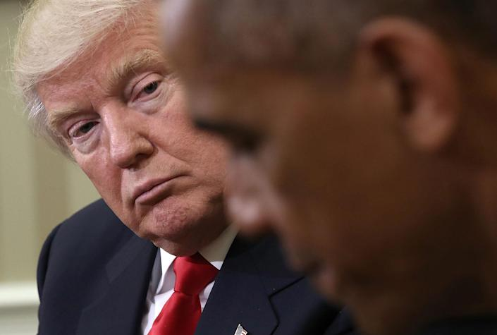 <p>President Obama speaks while meeting with President-elect Donald Trump, left, following a meeting in the Oval Office on Nov. 10, 2016, in Washington, D.C. (Win McNamee/Getty Images) </p>