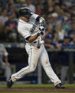 Seattle Mariners' Tom Murphy hits a three-run home run off of Kansas City Royals starting pitcher Danny Duffy that also scored J.P. Crawford and Daniel Vogelbach during the fifth inning of a baseball game, Monday, June 17, 2019, in Seattle. (AP Photo/Stephen Brashear)