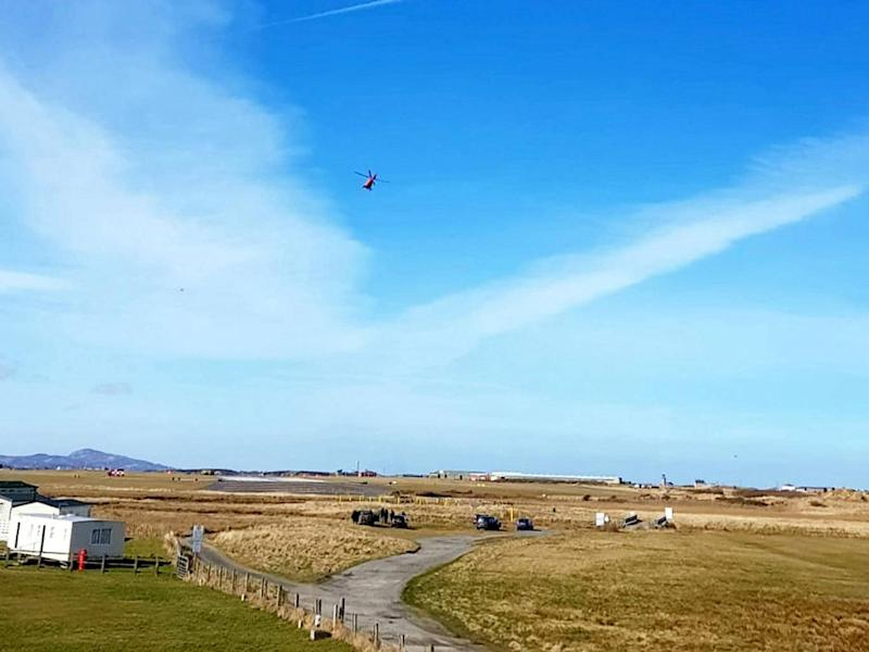 A helicopter is seen at RAF Valley after a Red Arrows Hawk jet crashed (SWNS)