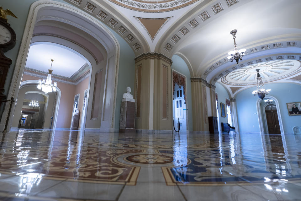 This June 30, 2021, photo shows the halls of the Capitol in Washington. The U.S. Capitol is still closed to most public visitors. It's the longest stretch ever that the building has been off-limits in its 200-plus year history. (AP Photo/Alex Brandon)