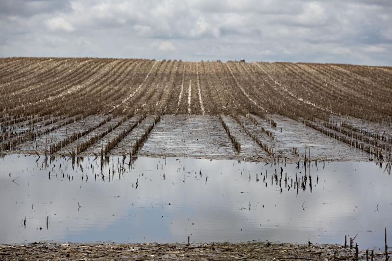 Water is seen flooding farmland in an aerial photograph taken over Wyanet, Illinois, U.S., on Wednesday, May 29, 2019. Claims known as prevented plant pay out when farmers are unable to sow crops at all. With unceasing rain keeping farmers out of fields, growers are increasingly weighing how best to get paid and ease the impact from the bad weather and an escalating U.S.-China trade war. Photographer: Daniel Acker/Bloomberg via Getty Images