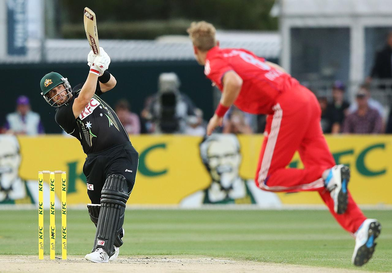 HOBART, AUSTRALIA - JANUARY 29:  Aaron Finch of Australia hits a six off Stuart Broad of England during game one of the International Twenty20 series between Australia and England at Blundstone Arena on January 29, 2014 in Hobart, Australia.  (Photo by Michael Dodge/Getty Images)