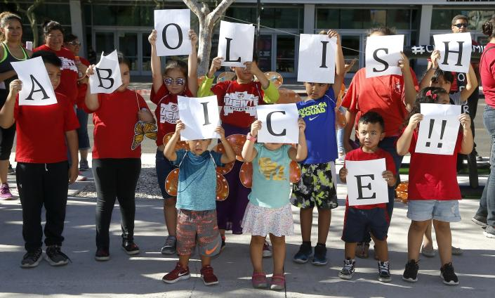 <p>Kids hold up signs during an immigration family separation protest in front of the Sandra Day O'Connor U.S. District Court building, Monday, June 18, 2018, in Phoenix, Ariz. An unapologetic President Trump defended his administration's border-protection policies Monday in the face of rising national outrage over the forced separation of migrant children from their parents. (Photo: Ross D. Franklin/AP) </p>